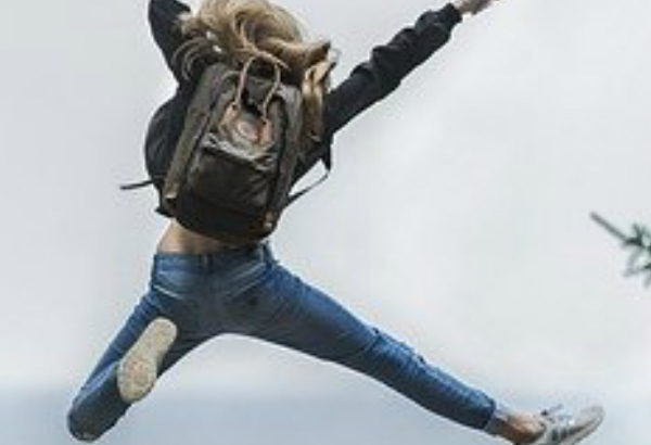 girl jumping with joy as she knows how to be happy