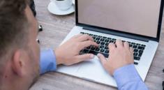 man on laptop making money writing online