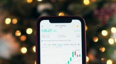 mobile phone being used for investing money for profits